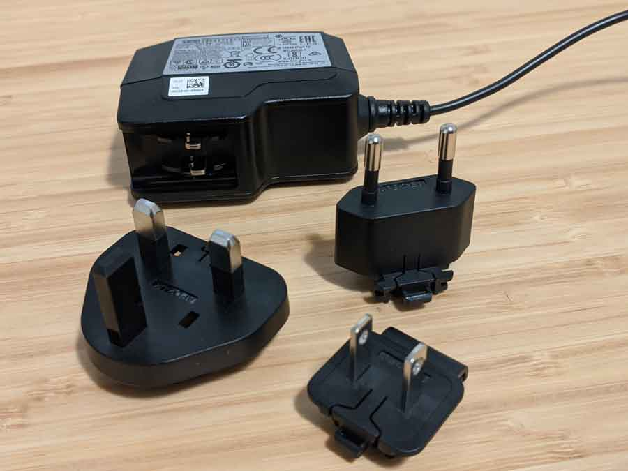 Different power plugs on a universal adapter